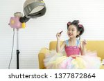 cute little girl playing with... | Shutterstock . vector #1377872864