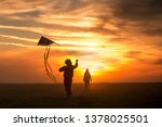 flying a kite. girl and boy fly ... | Shutterstock . vector #1378025501
