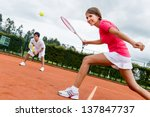 woman playing doubles in tennis ... | Shutterstock . vector #137847737