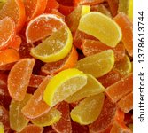 Small photo of Macro photo multi-colored marmalade jelly candy's. Dessert marmalade in the form of lemon and orange slices. The sweetness of jelly candy yellow and orange.