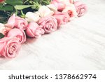 pink roses on the wooden desk | Shutterstock . vector #1378662974