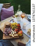 wine  cheese  ham and fruits... | Shutterstock . vector #1378761137