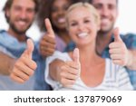 happy fashionable group giving... | Shutterstock . vector #137879069