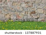 Stone Wall And Green Grass