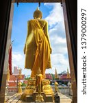 Back Of Golden Standing Buddha...
