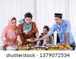 group of muslim people eating... | Shutterstock . vector #1379072534