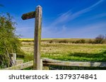 wooden public footpath sign on... | Shutterstock . vector #1379374841