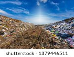 Small photo of Large garbage mountains that accumulate waste from industrial and urban areas in the 3rd world country.