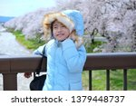 asian girls wearing blue... | Shutterstock . vector #1379448737
