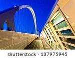 REGGIO EMILIA, ITALY - APRIL 06: famous bridges complex by architect Santiago Calatrava in Reggio Emilia on April 06, 2012. The central arch of the bridge is 220 meters long and 50 meters high - stock photo