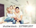 happy family siting on sofa at... | Shutterstock . vector #1379891357