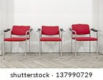 Three Red Chairs Before A Whit...
