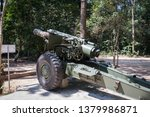 Front view of a 155mm Vietnam War artillery on display at the Cu Chi Tunnels in Saigon, Vietnam.