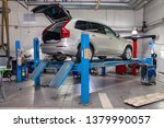 Small photo of Novosibirsk, Russia - 08.01.2018: Beige used car Volvo XC90 with opened trunk stands on the stand wheel alignment convergence of the car in the workshop for repair of vehicles. Auto service industry.