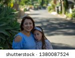 latina mother and daughter... | Shutterstock . vector #1380087524