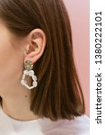 earrings on the ears hang.... | Shutterstock . vector #1380222101