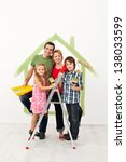 Happy family with kids redecorating their home together - stock photo