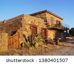 old stone house on a country... | Shutterstock . vector #1380401507