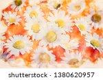 beautiful daisies on an orange... | Shutterstock . vector #1380620957