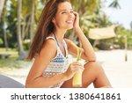 happy girl is drinking fruit...   Shutterstock . vector #1380641861