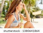 happy girl is drinking fruit...   Shutterstock . vector #1380641864