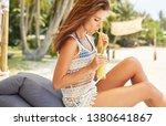 happy girl is drinking fruit...   Shutterstock . vector #1380641867