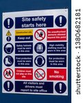 Small photo of Work site safety reminder board showing various cautionary, warning,and prohibitory signs