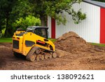 Yellow Bulldozer In Front Of...
