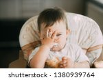 the baby in the kitchen... | Shutterstock . vector #1380939764