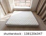 grey mattress on the floor... | Shutterstock . vector #1381206347
