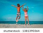 happy little boy and girl jump... | Shutterstock . vector #1381390364
