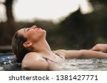 mid adult woman relaxing in a... | Shutterstock . vector #1381427771