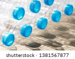 stack of plastic bottles on the ... | Shutterstock . vector #1381567877
