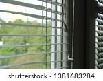 blinds on a room window | Shutterstock . vector #1381683284