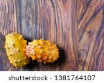 A pair of kiwano fruits on the...