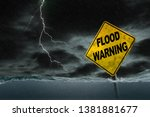 flood warning sign submerged in ...   Shutterstock . vector #1381881677