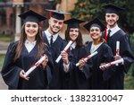 happy graduates. five college... | Shutterstock . vector #1382310047