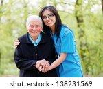 portrait of caring nurse... | Shutterstock . vector #138231569