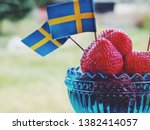 strawberries with swedish flags.... | Shutterstock . vector #1382414057