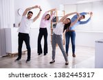 group of happy young... | Shutterstock . vector #1382445317