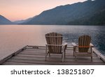 chairs on dock of lake crescent | Shutterstock . vector #138251807