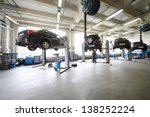 four black cars on lifts in... | Shutterstock . vector #138252224