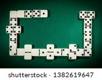 stacks of dominoes on a table... | Shutterstock . vector #1382619647