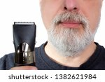 gray haired man holds an... | Shutterstock . vector #1382621984