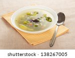 plate of vegetable soup  napkin ...