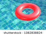Red Rubber Rings In The Pool....