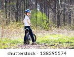 young boy riding a bike in the... | Shutterstock . vector #138295574