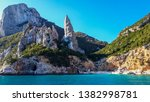 Rock formation at the beautiful beach of Cala Goloritze in the Gulf of Orosei, view from boat.