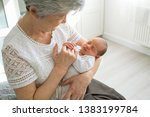great grandmother plays with a...   Shutterstock . vector #1383199784