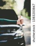 hitchhiking broken car on... | Shutterstock . vector #1383203867